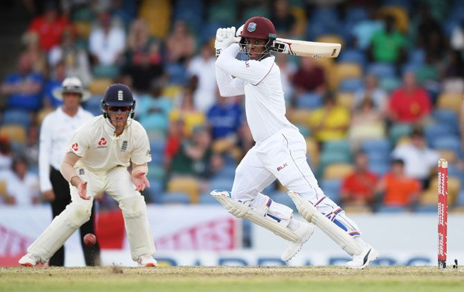 West Indies' Shimron Hetmyer plays a shot as England's Keaton Jennings looks on. Hetmeyer's rear guard with Shane Dowrich helped steady hosts in 2nd innings
