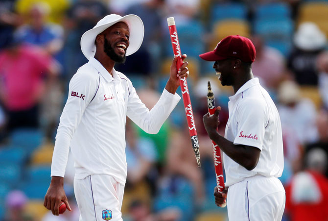 Rediff Cricket - Indian cricket - PIX: Part-time spinner Chase stars as Windies crush England