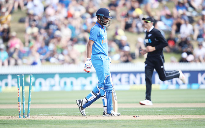 Bhuvneshwar Kumar leaves the field after being bowled by Colin de Grandhomme