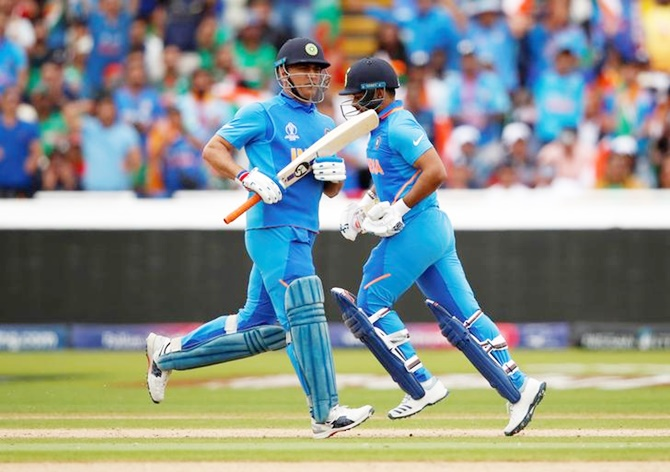 India's Mahendra Singh Dhoni and Rishabh Pant take a quick single in Tuesday's World Cup match against Bangladesh.