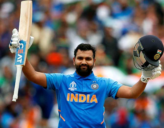 Rohit Sharma celebrates scoring a hundred against Bangladesh in the World Cup