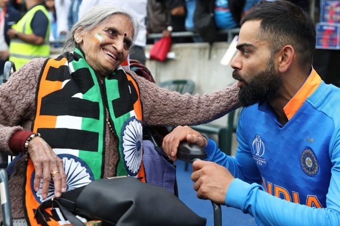 87-year-old Charulata Patel, a self-confessed India cricket fan chats with Virat Kohli after India's match against Bangladesh at Edgbaston on on July 3