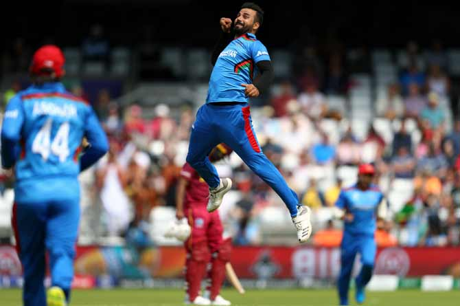 Afghanistan's Dawlat Zadran celebrates capturing the wicket of West Indies' Chris Gayle