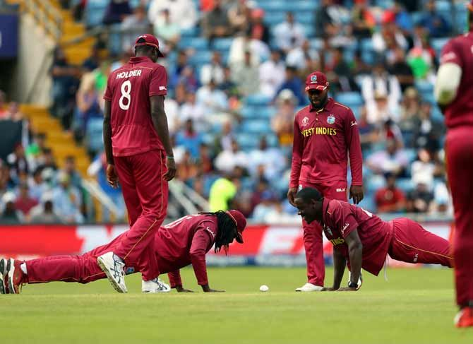 vChris Gayle, left, and Carlos Brathwaite do press ups in celebration of Gayle's catch to dismiss Afghanistan's Rahmat Shah during their match at Headingley in Leeds. on July 4