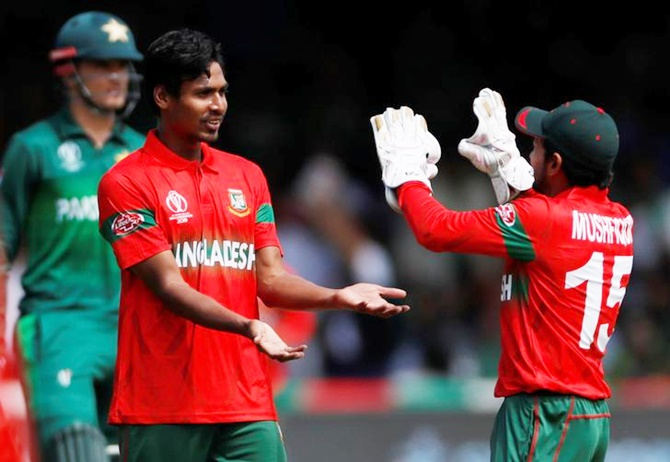 Mustafizur Rahman celebrates dismissing Mohammad Amir, his fifth wicket in the innings.