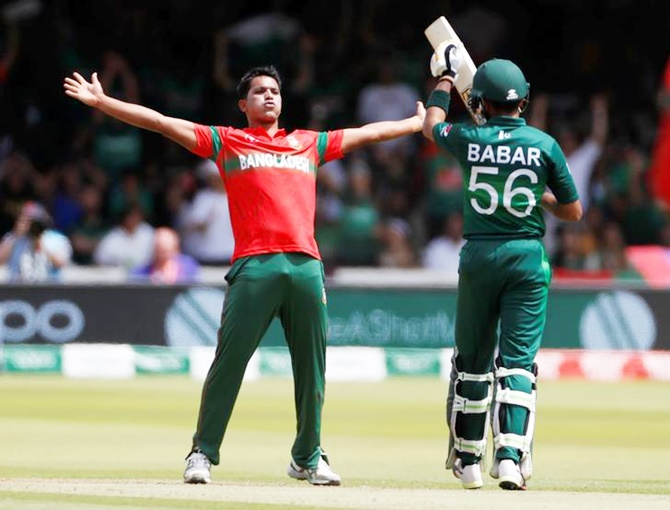 Mohammad Saifuddin, who fininshed with a four-wicket haul, celebrates taking the wicket of Babar Azam.