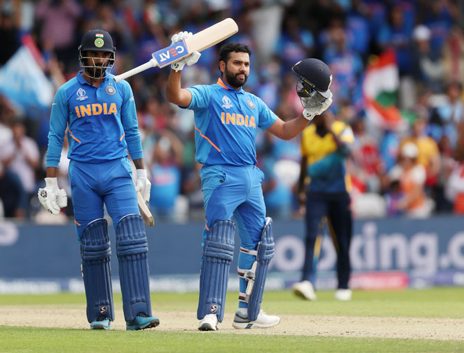 India's Rohit Sharma celebrates after scoring his century against Sri Lanka