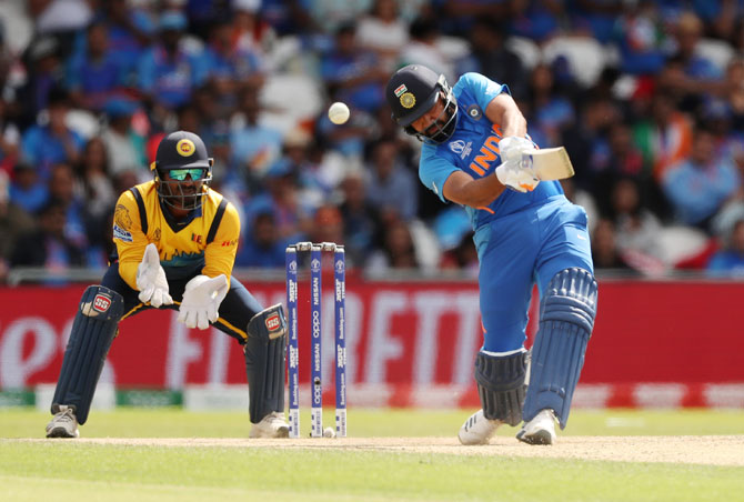 India's Rohit Sharma bats en route his century against Sri Lanka on Saturday