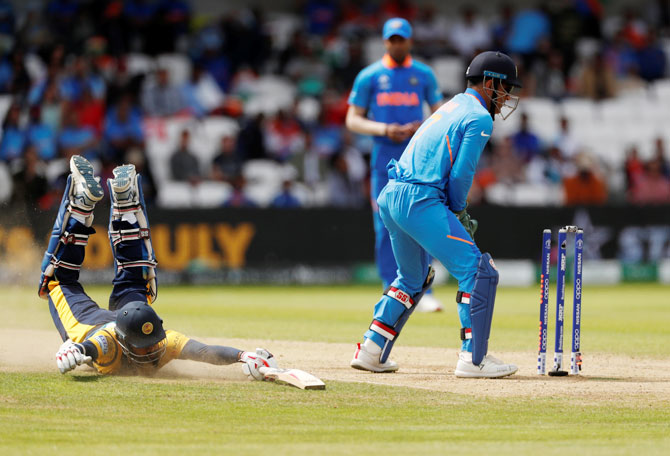Sri Lanka's Lahiru Thirimanne dives to make his ground while snatching a quick run