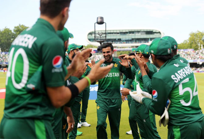 Shoaib Malik is greeted by his teammates after the match against Bangladesh on Friday