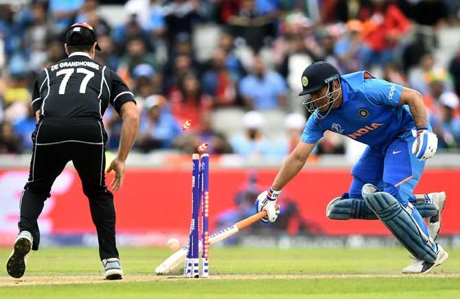 Mahendra Singh Dhoni is run out by a direct hit from Martin Guptill