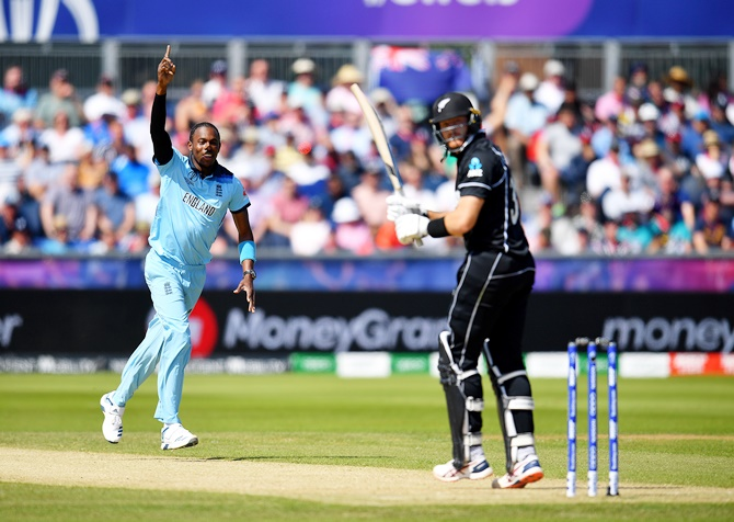 England's Jofra Archer of England celebrates dismissing New Zealand's Martin Guptill