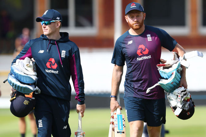 England captain Eoin Morgan (left) and Jonny Bairstow head towards the Nursery End for a nets session on the eve of the ICC Cricket World Cup final against New Zealand at Lord's Cricket Ground on Saturday