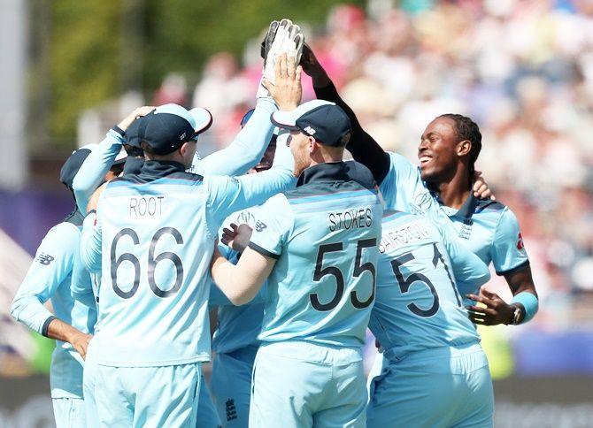 England's players celebrate the fall of a wicket at the World Cup.