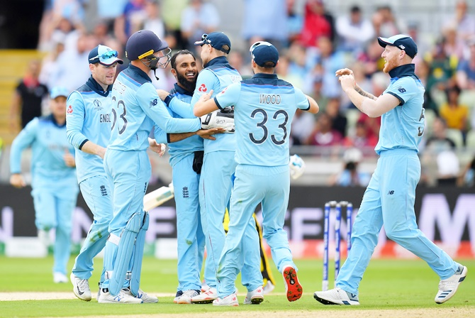 ngland spinner Adil Rashid celebrates with teammates after taking the wicket of Australia's Pat Cummins during the World Cup semi-final at Edgbaston, in Birmingham