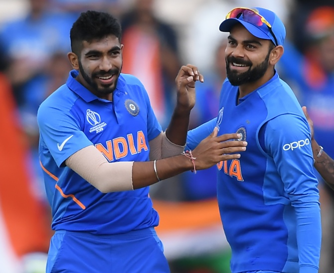 Jasprit Bumrah and Virat Kohli celebrate Quinton De Kock's wicket at The Hampshire Bowl in Southampton on June 5, 2019.