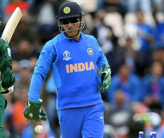 IMAGE: The regimental dagger insignia of the para forces visible on Mahendra Singh Dhoni's wicket-keeping gloves during the World Cup match against South Africa. Photograph: Alex Davidson/Getty Images