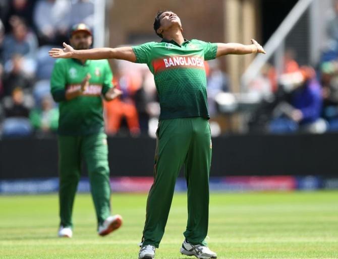 Bangladesh's Mohammad Saifuddin celebrates the wicket of England's Jos Buttler