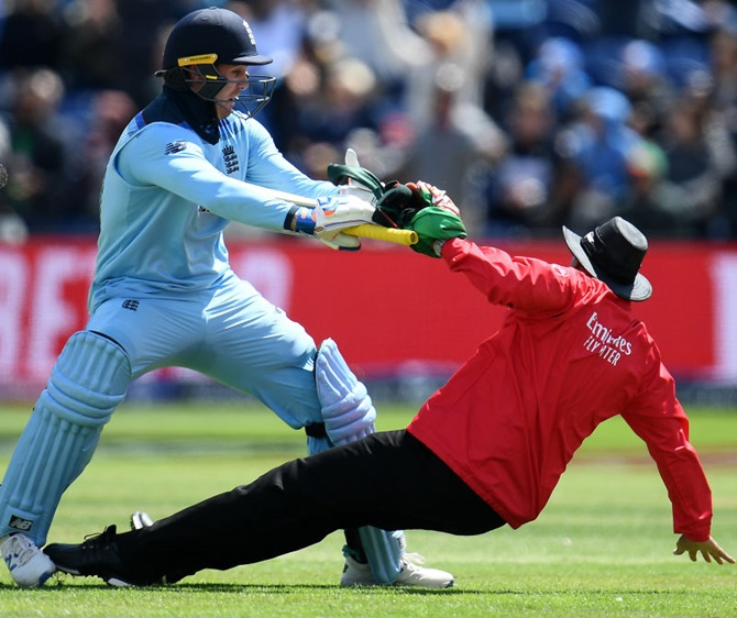 Jason Roy collides with umpire Joel Wilson as he prepares to celebrate his century against Bangladesh in Cardiff on June 8