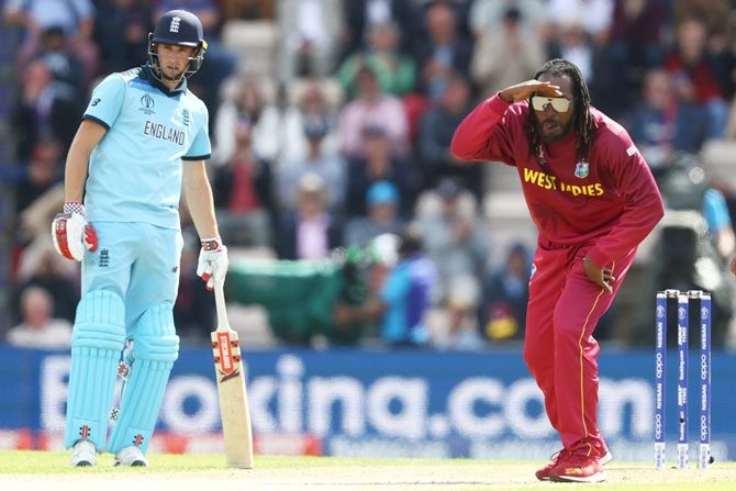 Chris Gayle looks with comic aggression following a delivery to Joe Root as Chris Woakes backs up during their match in Southampton on June 15