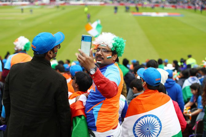 An India supporter takes a selfie ahead of the big match