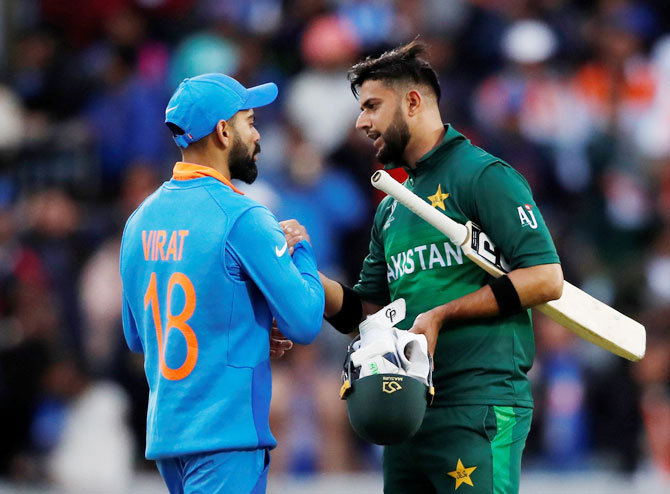 India's Virat Kohil and Pakistan's Shadab Khan share pleasantries after the match