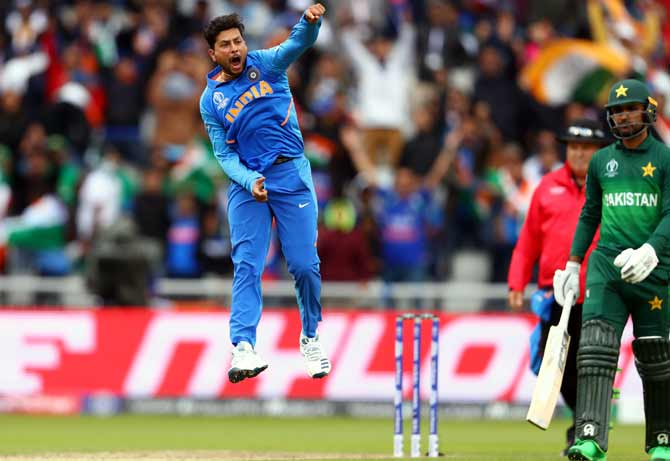 Kuldeep Yadav celebrates Babar Azam's wicket during their World Cup match on June 16