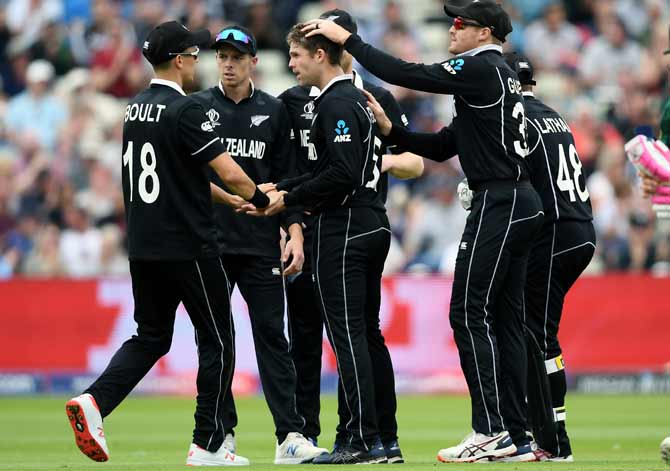 Lockie Ferguson, centre,  (is congratulated by teammates after taking  the wicket of Faf du Plessis