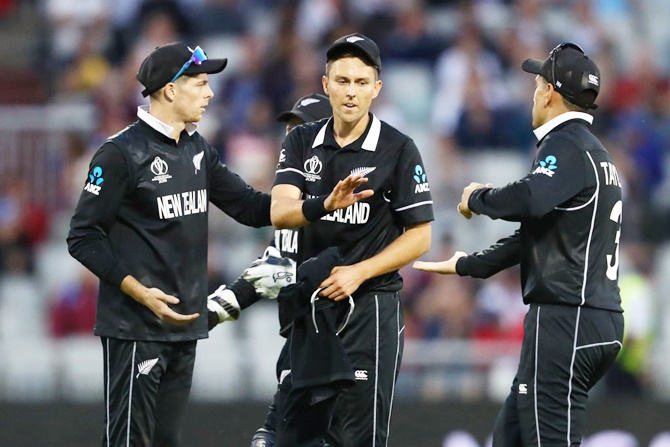 New Zealand's Trent Boult, center,  is congratulated by Mitchell Santner, left, and Ross Taylor