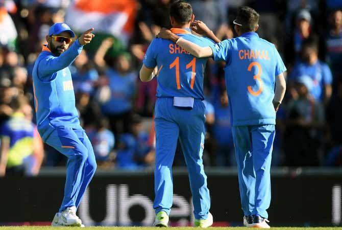 Mohammed Shami, centre, celebrates with Virat Kohli, left, and Yuzvendra Chahal after dismissing the well-set Mohammad Nabi during India's game against Afghanistan, June 22, 2019. Photograph: Alex Davidson/Getty Images