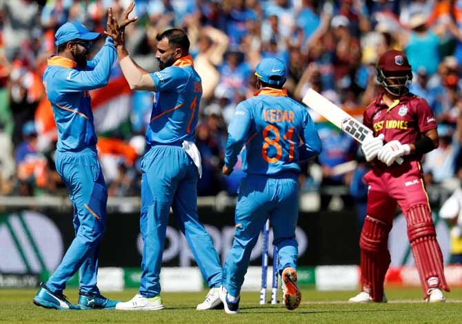 Mohammed Shami celebrates with teammates after scalping the wicket of West Indies' Shai Hope on Thursday. Shami picked up four wickets against West Indies in India's 125-run victory.