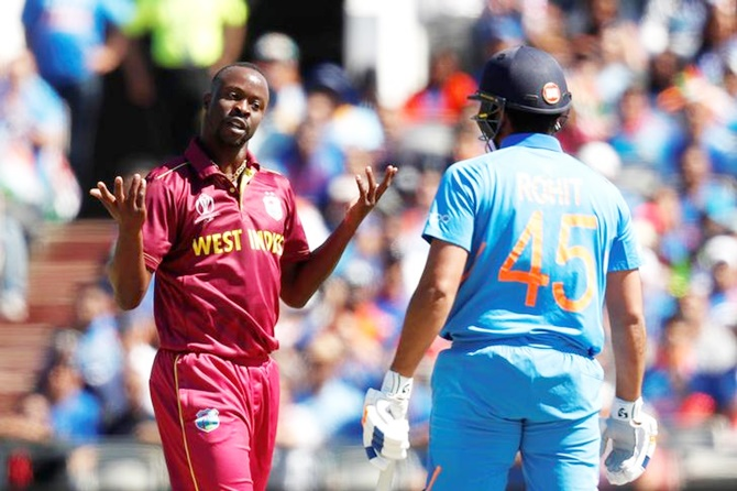 India's Rohit Sharma watches helplessly as West Indies' Kemar Roach celebrates his dismissal in Thursday's World Cup match.