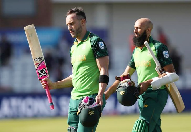 Faf du Plessis and Hashim Amla walk back after guiding South Africa to an easy victory over Sri Lanka in Friday's World Cup match in Chester-le-Street.
