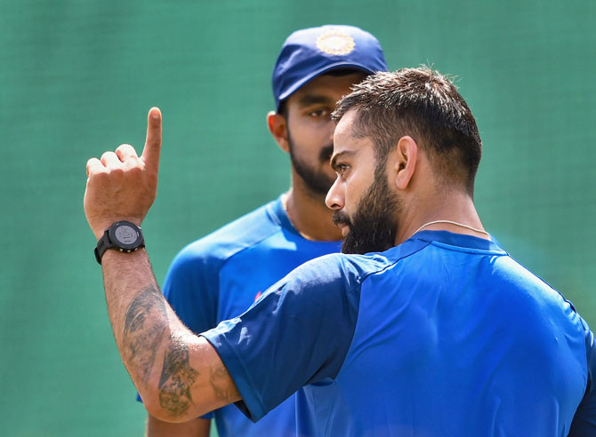 Vijay Shankar and Virat Kohli at a training session