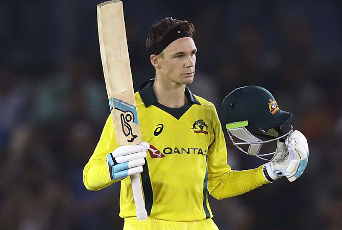 Peter Handscomb celebrates after completing his century against India at Mohali on Sunday