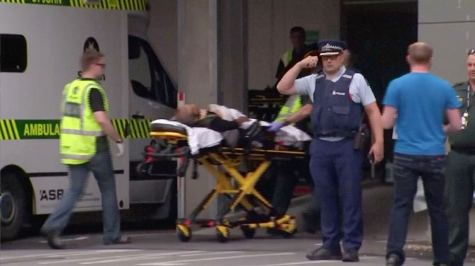 A video grab of a person being stretchered off at a hospital by emergency services personnel after reports that several shots had been fired, in central Christchurch, New Zealand on Friday