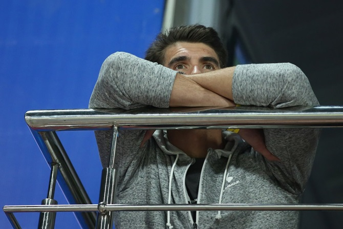 Michael Phelps, winner of 23 Olympic gold medals, watches the IPL match between Chennai Super Kings and Delhi Capitals from the Kotla balcony, in Delhi, on Tuesday, March 26