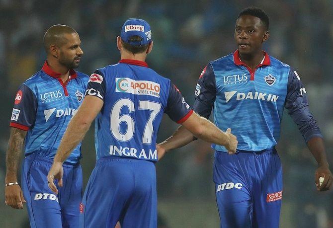Shikhar Dhawan, left, congratulates Kagiso Rabada, right, after the win against KKR