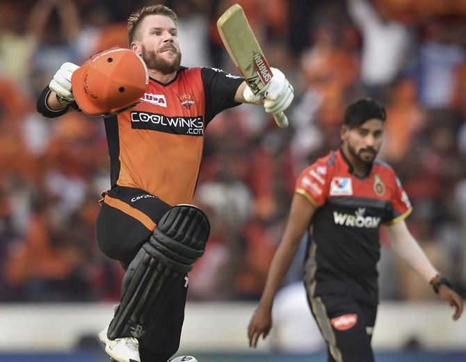 Sunrisers Hyderabad's David Warner celebrates after reaching his century