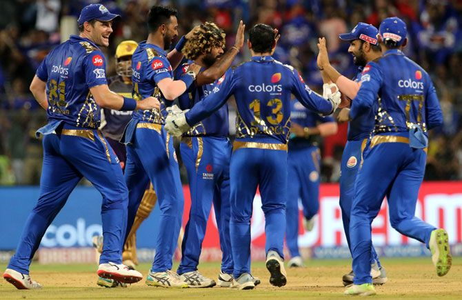 Mumbai Indians players celebrate the dismissal of Andre Russell