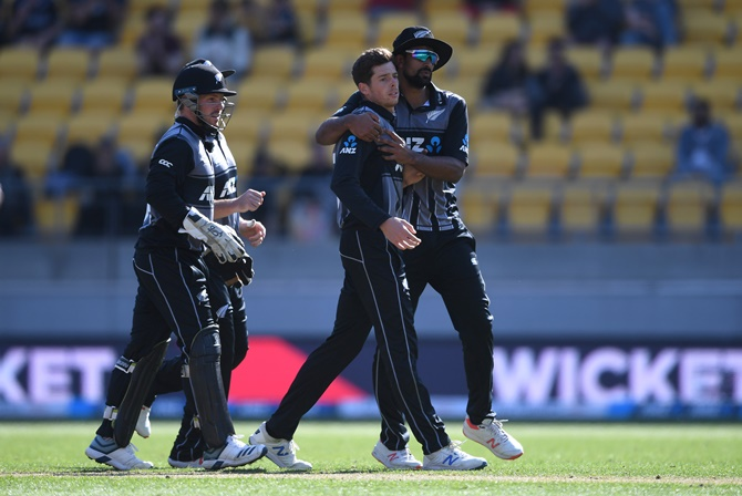 Mitchell Santner celebrates with his New Zealand teammates Ish Sodhi after dismissing Chris Jordan of England during Game 2 of the Twenty20 International series, at Westpac Stadium, in Wellington, on Sunday.