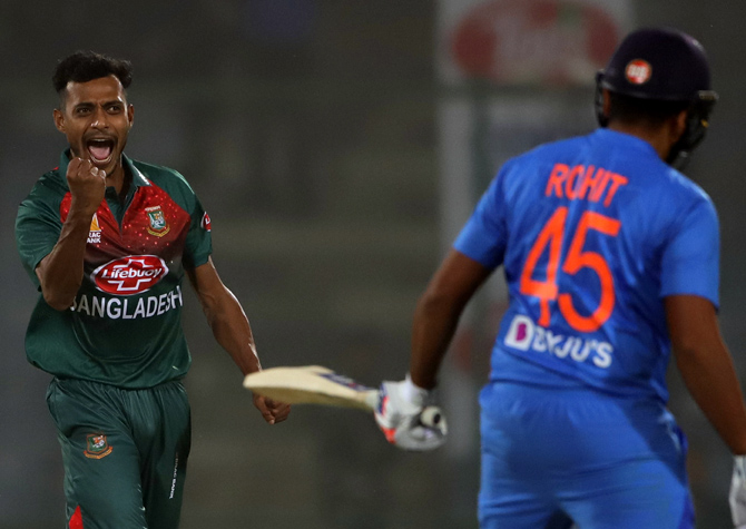 Shafiul Islam celebrates after dismissing Rohit Sharma