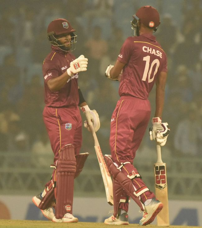 West Indies' Roston Chase and Shai Hope celebrate their win over Afghanistan in the 1st ODI in Lucknow on Wednesday