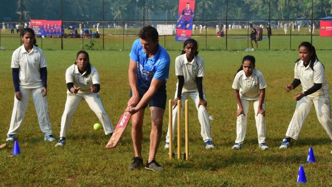 Former Australian cricketer Adam Gilchrist bats during the Cricket Charity Challenge in Mumbai on Wednesday