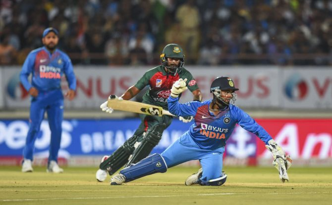 Rishabh Pant attempts a direct hit to run-out Liton Das during the 2nd T20I in Rajkot on Thursday