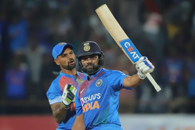 Rohit Sharma celebrates on completing his half-century.