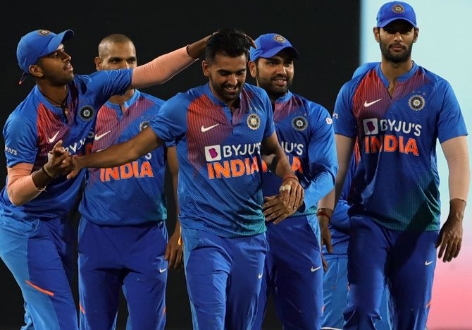 India's players congratulate Deepak Chahar, centre, on completing his hat-trick