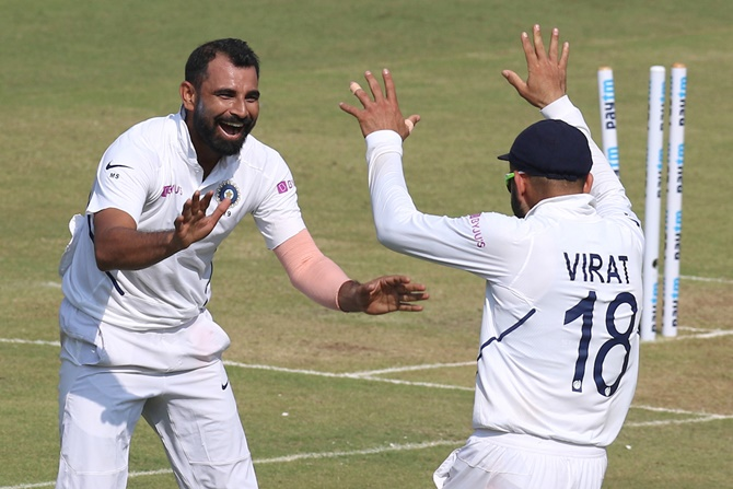India pacer Mohammed Shami celebrates with skipper Virat Kohli after dismissing Bangladesh batsman Mushfiqur Rahim