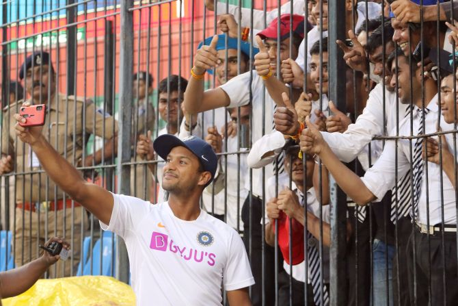 Mayank Agarwal takes a selfie with deaf and mute after Day 2's play at the Holkar Cricket Stadium, Indore on Friday