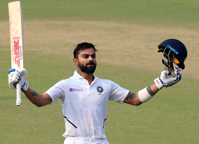 India captain Virat Kohli celebrates after completing his century on Day 2 of the 2nd Test at Eden Gardens in Kolkata on Saturday